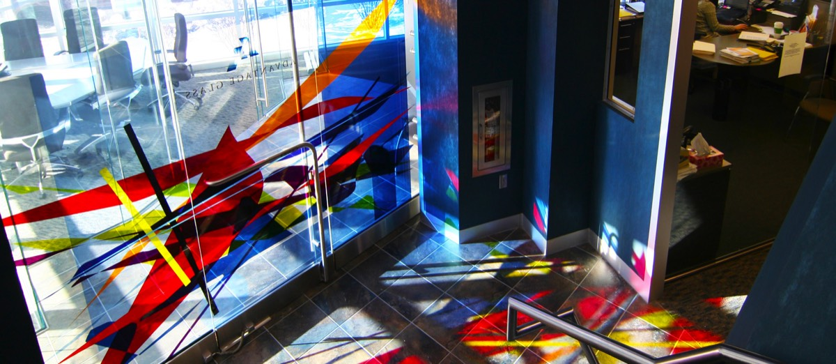 laminated art glass door with sunlight coming through